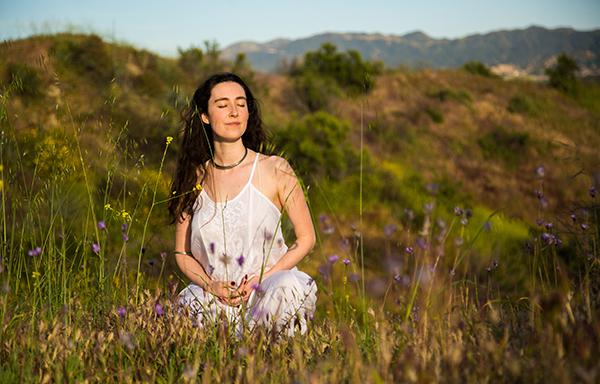 Isabella Frappier Womens Wellness Girl Sitting Field Green Hills White Dress